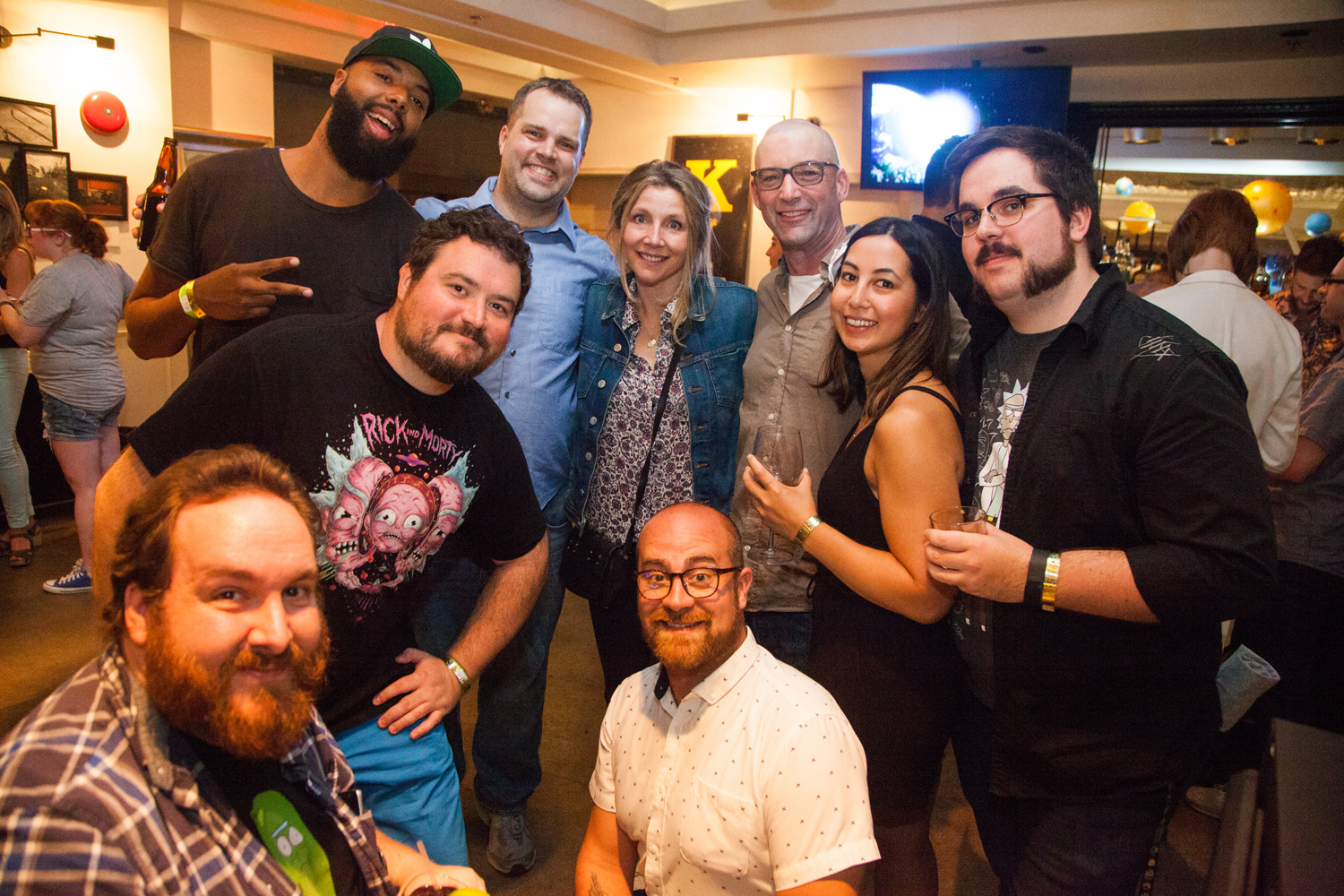 (Left middle, Nathan Litz with Cast and Crew from Rick and Morty)